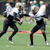 "Sherrard Henderson (23))at left, and Kenneth Crawley (2) work on a pass coverage drill during the University of Colorado football team practice on Monday August 20, 2012. <br /> For more photos go to  <a href=""http://www.buffzone.com"">http://www.buffzone.com</a><br /> Photo by Paul Aiken / The Boulder Camera"