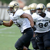 "De' Jon Wilson (90) turns to follow Andre Nichols (58) in a running drill during the University of Colorado football team practice on Monday August 20, 2012. <br /> For more photos go to  <a href=""http://www.buffzone.com"">http://www.buffzone.com</a><br /> Photo by Paul Aiken / The Boulder Camera"