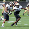"Josh Moten (39)) at left, and Brandon Brisco (35) work on a pass coverage drill during the University of Colorado football team practice on Monday August 20, 2012. <br /> For more photos go to  <a href=""http://www.buffzone.com"">http://www.buffzone.com</a><br /> Photo by Paul Aiken / The Boulder Camera"