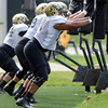 "Kirk Poston (91) hits a sled with his defense teammates during the University of Colorado football team practice on Monday August 20, 2012. <br /> For more photos go to  <a href=""http://www.buffzone.com"">http://www.buffzone.com</a><br /> Photo by Paul Aiken / The Boulder Camera"