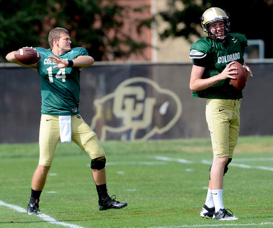 """Quarterbacks John Schrock (14) at left and Shane Dillon (7) make practice throws during the University of Colorado football team practice on Monday August 20, 2012. <br /> For more photos go to  <a href=""""http://www.buffzone.com"""">http://www.buffzone.com</a><br /> Photo by Paul Aiken / The Boulder Camera"""