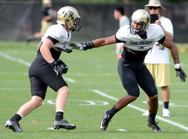 "Parker Orms (13)) at left, and Ray Polk (7) work on a pass coverage drill during the University of Colorado football team practice on Monday August 20, 2012. <br /> For more photos go to  <a href=""http://www.buffzone.com"">http://www.buffzone.com</a><br /> Photo by Paul Aiken / The Boulder Camera"