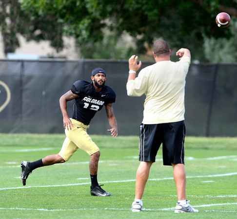"""Keenan Canty (12) tracks down a pass during the University of Colorado football team practice on Monday August 20, 2012. <br /> For more photos go to  <a href=""""http://www.buffzone.com"""">http://www.buffzone.com</a><br /> Photo by Paul Aiken / The Boulder Camera"""
