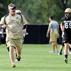0805cufb248.JPG Coach Dan Hawkins charges down the field during the CU football practice on Thursday, Aug. 5.<br /> Jeremy Papasso/ Camera