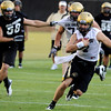 0805cufb463.JPG # 7 Quarertback Cody Hawkins, scrambles downfield during the CU football practice on Thursday, Aug. 5.<br /> Jeremy Papasso/ Camera