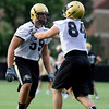0805cufb297.JPG #59 David Bakhtiari, works with #84 Alex Wood during the CU football practice on Thursday, Aug. 5.<br /> Jeremy Papasso/ Camera