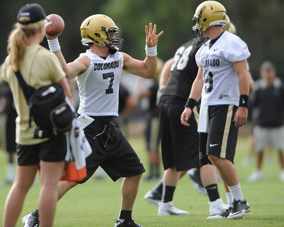 Cody Hawkins passes the football during the first fall football practice for the University of Colorado football team. August 5, 2010<br /> Photos by Mark Leffingwell / The Camera