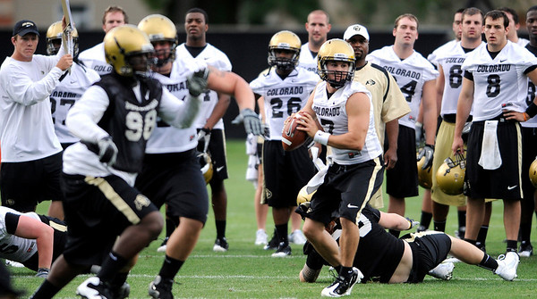 Cody Hawkins looks for a receiver during the first fall football practice for the University of Colorado football team. August 5, 2010<br /> Photos by Mark Leffingwell / The Camera