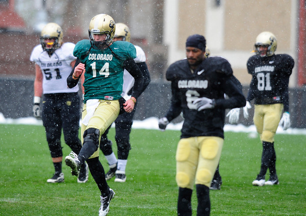 "Quarterback John Schrock (14) runs through warmups during the University of Colorado football team practice on the CU Boulder Campus on  Tuesday April 3, 2012.<br /> For more photos of the practice go to  <a href=""http://www.buffzone.com"">http://www.buffzone.com</a><br /> Photo by Paul Aiken / The Camera"