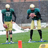 "Quarterback John Schrock (14) at right runs through a footwork exercise during the University of Colorado football team practice on the CU Boulder Campus on  Tuesday April 3, 2012. Quarterback Stevie Joe Dorman (12) waits his turn at left. <br /> For more photos of the practice go to  <a href=""http://www.buffzone.com"">http://www.buffzone.com</a><br /> Photo by Paul Aiken / The Camera"