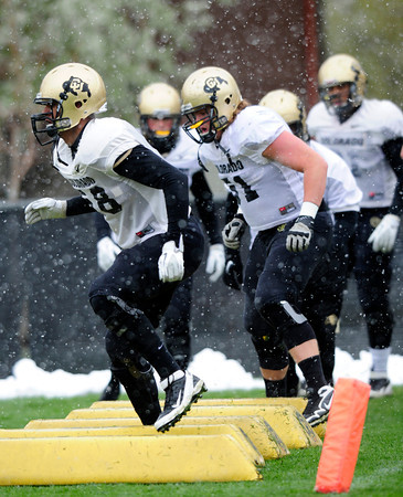 "Andre Nichols (58) runs an agility drill during the University of Colorado football team practice on the CU Boulder Campus on  Tuesday April 3, 2012.<br /> For more photos of the practice go to  <a href=""http://www.buffzone.com"">http://www.buffzone.com</a><br /> Photo by Paul Aiken / The Camera"