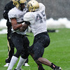 """Woodson Greer ((37) and Lowell Williams (45) work on a contact drill during the University of Colorado football team practice on the CU Boulder Campus on  Tuesday April 3, 2012.<br /> For more photos of the practice go to  <a href=""""http://www.buffzone.com"""">http://www.buffzone.com</a><br /> Photo by Paul Aiken / The Camera"""