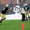 """Quarterback John Schrock (14) makes a throw to DaVaughn Thornton (85) during the University of Colorado football team practice on the CU Boulder Campus on  Tuesday April 3, 2012.<br /> For more photos of the practice go to  <a href=""""http://www.buffzone.com"""">http://www.buffzone.com</a><br /> Photo by Paul Aiken / The Camera"""