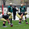 "From left to right Quarterbacks Connor Wood (5), John Schrock (14) and Stevie Joe Dorman (12) work together during a drill during the University of Colorado football team practice on the CU Boulder Campus on  Tuesday April 3, 2012.<br /> For more photos of the practice go to  <a href=""http://www.buffzone.com"">http://www.buffzone.com</a><br /> Photo by Paul Aiken / The Camera"