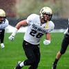 """Will Harlos (28) works on an agility drill during the University of Colorado football team practice on the CU Boulder Campus on  Tuesday April 3, 2012.<br /> For more photos of the practice go to  <a href=""""http://www.buffzone.com"""">http://www.buffzone.com</a><br /> Photo by Paul Aiken / The Camera"""