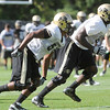 Andre Nichols, 58, left and Stephane Nembot, 90, work in speed reaction drills with the defense during the Monday August 22, 2011 CU football team practice.<br /> <br /> Photo by Paul Aiken / The Camera / August 22 2011