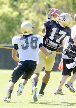 "Toney Clemons, 17, makes and over the shoulder catch while be covered by River Thompson, 38, during the University of Colorado Buffalos  Monday August 15 practice. FOR MORE PHOTOS AND VIDEO INTERVIEWS FROM THE PRACTICE GO TO  <a href=""http://WWW.BUFFZONE.COM"">http://WWW.BUFFZONE.COM</a> OR  <a href=""http://WWW.DAILYCAMERA.COM"">http://WWW.DAILYCAMERA.COM</a><br /> Photo by Paul Aiken / The Camera / 8/ 15/ 11"