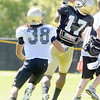 """Toney Clemons, 17, makes and over the shoulder catch while be covered by River Thompson, 38, during the University of Colorado Buffalos  Monday August 15 practice. FOR MORE PHOTOS AND VIDEO INTERVIEWS FROM THE PRACTICE GO TO  <a href=""""http://WWW.BUFFZONE.COM"""">http://WWW.BUFFZONE.COM</a> OR  <a href=""""http://WWW.DAILYCAMERA.COM"""">http://WWW.DAILYCAMERA.COM</a><br /> Photo by Paul Aiken / The Camera / 8/ 15/ 11"""