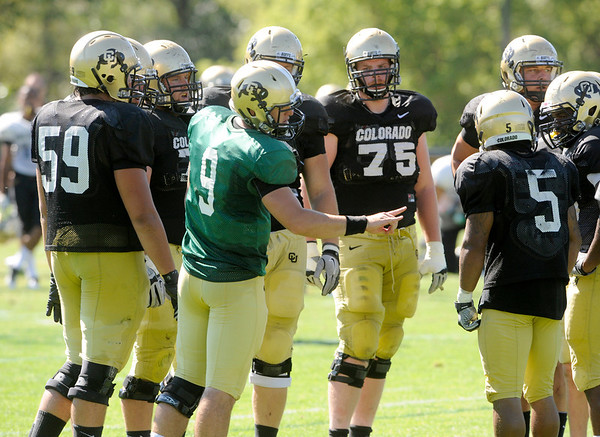 "Tyler Hansen, 9, talks to the offense during the University of Colorado Buffalos  Monday August 15 practice. FOR MORE PHOTOS AND VIDEO INTERVIEWS FROM THE PRACTICE GO TO  <a href=""http://WWW.BUFFZONE.COM"">http://WWW.BUFFZONE.COM</a> OR  <a href=""http://WWW.DAILYCAMERA.COM"">http://WWW.DAILYCAMERA.COM</a><br /> Photo by Paul Aiken / The Camera / 8/ 15/ 11"