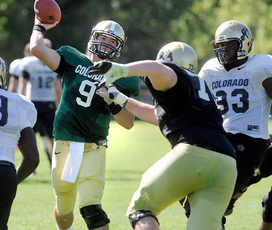 "Tyler Hansen throws under pressure during the University of Colorado Buffalos  Monday August 15 practice. FOR MORE PHOTOS AND VIDEO INTERVIEWS FROM THE PRACTICE GO TO  <a href=""http://WWW.BUFFZONE.COM"">http://WWW.BUFFZONE.COM</a> OR  <a href=""http://WWW.DAILYCAMERA.COM"">http://WWW.DAILYCAMERA.COM</a><br /> Photo by Paul Aiken / The Camera / 8/ 15/ 11"