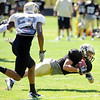 "Logan Gray, 2, makes a diving catch in front of Ayodeji Olatoye, 25,  during the University of Colorado Buffalos  Monday August 15 practice. FOR MORE PHOTOS AND VIDEO INTERVIEWS FROM THE PRACTICE GO TO  <a href=""http://WWW.BUFFZONE.COM"">http://WWW.BUFFZONE.COM</a> OR  <a href=""http://WWW.DAILYCAMERA.COM"">http://WWW.DAILYCAMERA.COM</a><br /> Photo by Paul Aiken / The Camera / 8/ 15/ 11"
