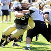 "Blake Behrens, 66, battles with Brady Daigh 54,  during the University of Colorado Buffalos  Monday August 15 practice. FOR MORE PHOTOS AND VIDEO INTERVIEWS FROM THE PRACTICE GO TO  <a href=""http://WWW.BUFFZONE.COM"">http://WWW.BUFFZONE.COM</a> OR  <a href=""http://WWW.DAILYCAMERA.COM"">http://WWW.DAILYCAMERA.COM</a><br /> Photo by Paul Aiken / The Camera / 8/ 15/ 11"