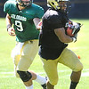 "Rodney Stewart, 5, takes a handoff from Tyler Hansen 9, during the University of Colorado Buffalos  Monday August 15 practice. FOR MORE PHOTOS AND VIDEO INTERVIEWS FROM THE PRACTICE GO TO  <a href=""http://WWW.BUFFZONE.COM"">http://WWW.BUFFZONE.COM</a> OR  <a href=""http://WWW.DAILYCAMERA.COM"">http://WWW.DAILYCAMERA.COM</a><br /> Photo by Paul Aiken / The Camera / 8/ 15/ 11"