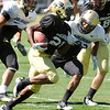 "Tony Jones, 26, tries to outrun Terrel Smith, 41 during the University of Colorado Buffalos  Monday August 15 practice. FOR MORE PHOTOS AND VIDEO INTERVIEWS FROM THE PRACTICE GO TO  <a href=""http://WWW.BUFFZONE.COM"">http://WWW.BUFFZONE.COM</a> OR  <a href=""http://WWW.DAILYCAMERA.COM"">http://WWW.DAILYCAMERA.COM</a><br /> Photo by Paul Aiken / The Camera / 8/ 15/ 11"