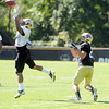 "Jonathan Hawkins,18, tips a pass that Nelson Spruce, 22, waits for during the University of Colorado Buffalos  Monday August 15 practice. FOR MORE PHOTOS AND VIDEO INTERVIEWS FROM THE PRACTICE GO TO  <a href=""http://WWW.BUFFZONE.COM"">http://WWW.BUFFZONE.COM</a> OR  <a href=""http://WWW.DAILYCAMERA.COM"">http://WWW.DAILYCAMERA.COM</a><br /> Photo by Paul Aiken / The Camera / 8/ 15/ 11"