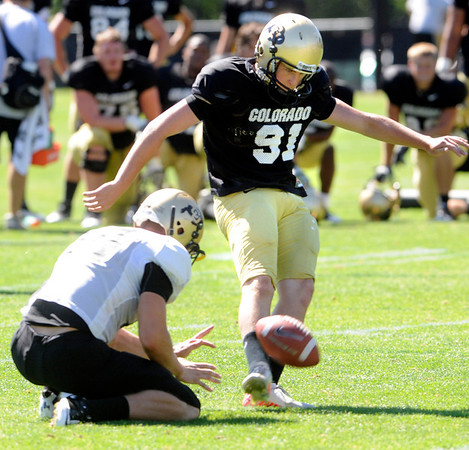 "Will Oliver, 91, knocks a field goal during the University of Colorado Buffalos  Monday August 15 practice. FOR MORE PHOTOS AND VIDEO INTERVIEWS FROM THE PRACTICE GO TO  <a href=""http://WWW.BUFFZONE.COM"">http://WWW.BUFFZONE.COM</a> OR  <a href=""http://WWW.DAILYCAMERA.COM"">http://WWW.DAILYCAMERA.COM</a><br /> Photo by Paul Aiken / The Camera / 8/ 15/ 11"