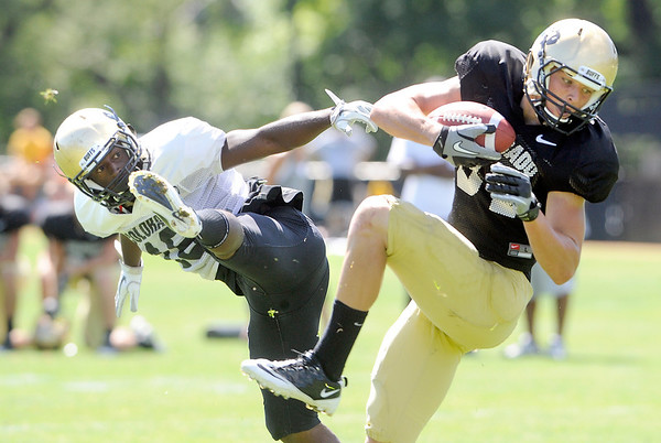 "Tyler McCulloch, 87, grabs a pass while Makiri Pugh, 16, defends  during the University of Colorado Buffalos  Monday August 15 practice. FOR MORE PHOTOS AND VIDEO INTERVIEWS FROM THE PRACTICE GO TO  <a href=""http://WWW.BUFFZONE.COM"">http://WWW.BUFFZONE.COM</a> OR  <a href=""http://WWW.DAILYCAMERA.COM"">http://WWW.DAILYCAMERA.COM</a><br /> Photo by Paul Aiken / The Camera / 8/ 15/ 11"