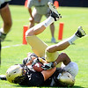 "Logan Gray, 2, hangs onto the ball for a touchdown as Greg Henderson, 20, defends during the University of Colorado Buffalos  Monday August 15 practice. FOR MORE PHOTOS AND VIDEO INTERVIEWS FROM THE PRACTICE GO TO  <a href=""http://WWW.BUFFZONE.COM"">http://WWW.BUFFZONE.COM</a> OR  <a href=""http://WWW.DAILYCAMERA.COM"">http://WWW.DAILYCAMERA.COM</a><br /> Photo by Paul Aiken / The Camera / 8/ 15/ 11"