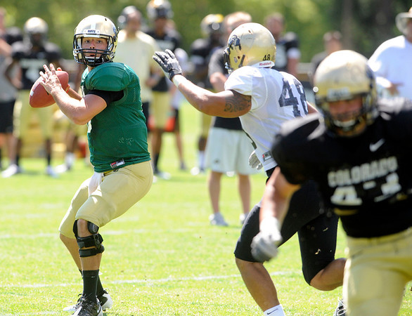 "Brent Burnette, 10, looks downfield to pass during the University of Colorado Buffalos  Monday August 15 practice. FOR MORE PHOTOS AND VIDEO INTERVIEWS FROM THE PRACTICE GO TO  <a href=""http://WWW.BUFFZONE.COM"">http://WWW.BUFFZONE.COM</a> OR  <a href=""http://WWW.DAILYCAMERA.COM"">http://WWW.DAILYCAMERA.COM</a><br /> Photo by Paul Aiken / The Camera / 8/ 15/ 11"