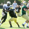 "Rodney Stewart, 5, keeps Chidera Uzo-Diribe, 9, away from Tyler Hansen, 9,  during the University of Colorado Buffalos  Monday August 15 practice. FOR MORE PHOTOS AND VIDEO INTERVIEWS FROM THE PRACTICE GO TO  <a href=""http://WWW.BUFFZONE.COM"">http://WWW.BUFFZONE.COM</a> OR  <a href=""http://WWW.DAILYCAMERA.COM"">http://WWW.DAILYCAMERA.COM</a><br /> Photo by Paul Aiken / The Camera / 8/ 15/ 11"