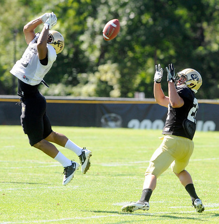 "Jonathan Hawkins,18, tips a pass that Nelson Spruce, can't gather in during the University of Colorado Buffalos  Monday August 15 practice. FOR MORE PHOTOS AND VIDEO INTERVIEWS FROM THE PRACTICE GO TO  <a href=""http://WWW.BUFFZONE.COM"">http://WWW.BUFFZONE.COM</a> OR  <a href=""http://WWW.DAILYCAMERA.COM"">http://WWW.DAILYCAMERA.COM</a><br /> Photo by Paul Aiken / The Camera / 8/ 15/ 11"