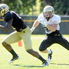 "Toney Clemons, 17,  breaks away from Arthur Jaffee, 22, after making a catch during the University of Colorado Buffalos  Monday August 15 practice. FOR MORE PHOTOS AND VIDEO INTERVIEWS FROM THE PRACTICE GO TO  <a href=""http://WWW.BUFFZONE.COM"">http://WWW.BUFFZONE.COM</a> OR  <a href=""http://WWW.DAILYCAMERA.COM"">http://WWW.DAILYCAMERA.COM</a><br /> Photo by Paul Aiken / The Camera / 8/ 15/ 11"