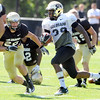 "Josh Moten, 39, returns an interception as Nelson Spruce, 22, closes in during the University of Colorado Buffalos  Monday August 15 practice. FOR MORE PHOTOS AND VIDEO INTERVIEWS FROM THE PRACTICE GO TO  <a href=""http://WWW.BUFFZONE.COM"">http://WWW.BUFFZONE.COM</a> OR  <a href=""http://WWW.DAILYCAMERA.COM"">http://WWW.DAILYCAMERA.COM</a><br /> Photo by Paul Aiken / The Camera / 8/ 15/ 11"