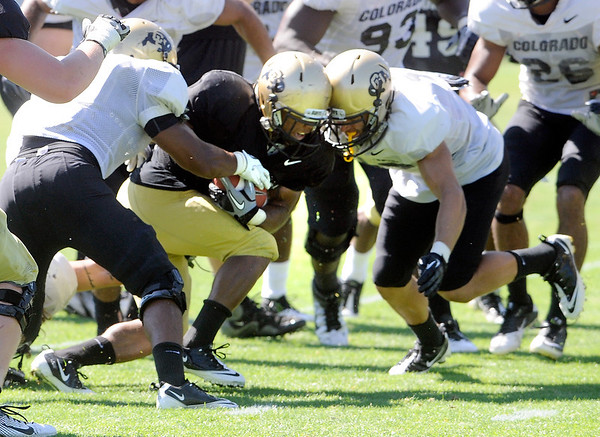"Rodney Stewart, 5, goes helmet to helmet with Travis Sandersfeld, 19, during the University of Colorado Buffalos  Monday August 15 practice. FOR MORE PHOTOS AND VIDEO INTERVIEWS FROM THE PRACTICE GO TO  <a href=""http://WWW.BUFFZONE.COM"">http://WWW.BUFFZONE.COM</a> OR  <a href=""http://WWW.DAILYCAMERA.COM"">http://WWW.DAILYCAMERA.COM</a><br /> Photo by Paul Aiken / The Camera / 8/ 15/ 11"