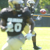 "Toney Clemons, 17,  hauls in a pass during the University of Colorado Buffalos  Monday August 15 practice. FOR MORE PHOTOS AND VIDEO INTERVIEWS FROM THE PRACTICE GO TO  <a href=""http://WWW.BUFFZONE.COM"">http://WWW.BUFFZONE.COM</a> OR  <a href=""http://WWW.DAILYCAMERA.COM"">http://WWW.DAILYCAMERA.COM</a><br /> Photo by Paul Aiken / The Camera / 8/ 15/ 11"