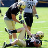 "Tyler McCulloch, 87, is slow to get up after making a tough catch as Logan Gray, 2, gives a hand during the University of Colorado Buffalos  Monday August 15 practice. FOR MORE PHOTOS AND VIDEO INTERVIEWS FROM THE PRACTICE GO TO  <a href=""http://WWW.BUFFZONE.COM"">http://WWW.BUFFZONE.COM</a> OR  <a href=""http://WWW.DAILYCAMERA.COM"">http://WWW.DAILYCAMERA.COM</a><br /> Photo by Paul Aiken / The Camera / 8/ 15/ 11"