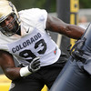 "Conrad Obi, works on a pass rushing drill during the University of Colorado football team practice in Boulder  on Thursday August 11, 2011.<br /> For more photos and video interviews from the practice go to  <a href=""http://www.dailycamera.com"">http://www.dailycamera.com</a><br /> Photo by Paul Aiken  August 11, 2011."