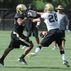 "Cordary Allen, 33, can't hang on to a pass while being defended by Will Harlos, 28, during the University of Colorado football team practice in Boulder  on Thursday August 11, 2011.<br /> For more photos and video interviews from the practice go to  <a href=""http://www.dailycamera.com"">http://www.dailycamera.com</a><br /> Photo by Paul Aiken  August 11, 2011."