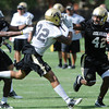 "Josh Ford, 42, gives a stiff arm to Paul Vigo during the University of Colorado football team practice in Boulder  on Thursday August 11, 2011.<br /> For more photos and video interviews from the practice go to  <a href=""http://www.dailycamera.com"">http://www.dailycamera.com</a><br /> Photo by Paul Aiken  August 11, 2011."