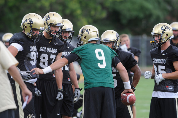 "Quarterback Tyler Hansen has the attention of the offense during the University of Colorado football team practice in Boulder  on Thursday August 11, 2011.<br /> For more photos and video interviews from the practice go to  <a href=""http://www.dailycamera.com"">http://www.dailycamera.com</a><br /> Photo by Paul Aiken  August 11, 2011."