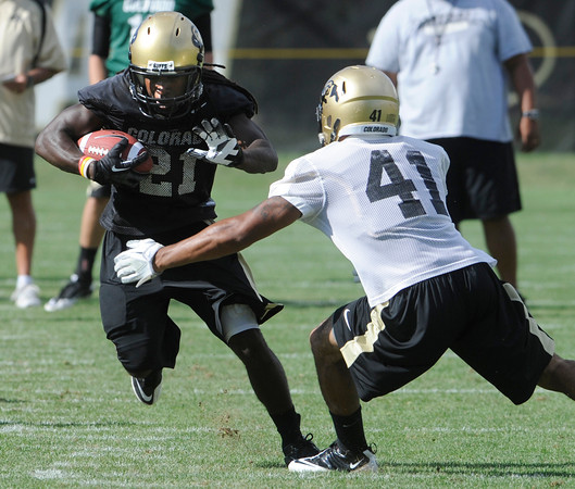 "D.D. Goodson, 21, runs against Terrel Smith, 41, during the University of Colorado football team practice in Boulder  on Thursday August 11, 2011.<br /> For more photos and video interviews from the practice go to  <a href=""http://www.dailycamera.com"">http://www.dailycamera.com</a><br /> Photo by Paul Aiken  August 11, 2011."