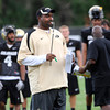 "Head Coach Jon Embree shows a rare smile as the offense scores during the University of Colorado football team practice in Boulder  on Thursday August 11, 2011.<br /> For more photos and video interviews from the practice go to  <a href=""http://www.dailycamera.com"">http://www.dailycamera.com</a><br /> Photo by Paul Aiken  August 11, 2011."