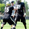 "University of Colorado's Jack Harris, No. 75, hits teammate Stephane Nembot during fall football camp at the CU practice field on Wednesday, Aug. 8. For more photos of the practice go to  <a href=""http://www.dailycamera.com"">http://www.dailycamera.com</a><br /> Jeremy Papasso/ Camera"