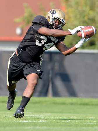"University of Colorado's Terrence Crowder makes a catch during fall football camp at the CU practice field on Wednesday, Aug. 8. For more photos of the practice go to  <a href=""http://www.dailycamera.com"">http://www.dailycamera.com</a><br /> Jeremy Papasso/ Camera"