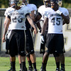 "University of Colorado's Lowell Williams, No. 45, and Sherrard Harrington, No. 23, wait for their turn in a drill during fall football camp at the CU practice field on Wednesday, Aug. 8. For more photos of the practice go to  <a href=""http://www.dailycamera.com"">http://www.dailycamera.com</a><br /> Jeremy Papasso/ Camera"