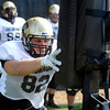 "University of Colorado's John Stuart hits the sled during fall football camp at the CU practice field on Wednesday, Aug. 8. For more photos of the practice go to  <a href=""http://www.dailycamera.com"">http://www.dailycamera.com</a><br /> Jeremy Papasso/ Camera"